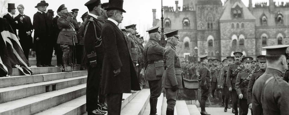 His Royal Highness the Duke of Connaught, Governor General of Canada; Prime Minister Sir Robert Borden; and Major-General Sir Sam Hughes, Minister of Militia and Defence, with staff, inspect the new contingents for the First World War, on Parliament Hill. Credit: Samuel J. Jarvis / Library and Archives Canada / PA-025088