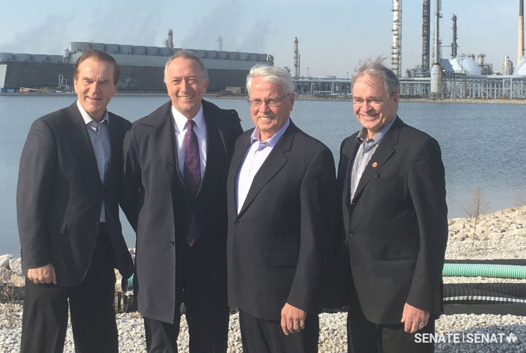 Pictured, from left to right : Senators Percy Mockler, Paul Massicotte, Richard Neufeld and Dennis Patterson pose in front of the NOVA Chemicals manufacturing plant in Sarnia, Ontario.