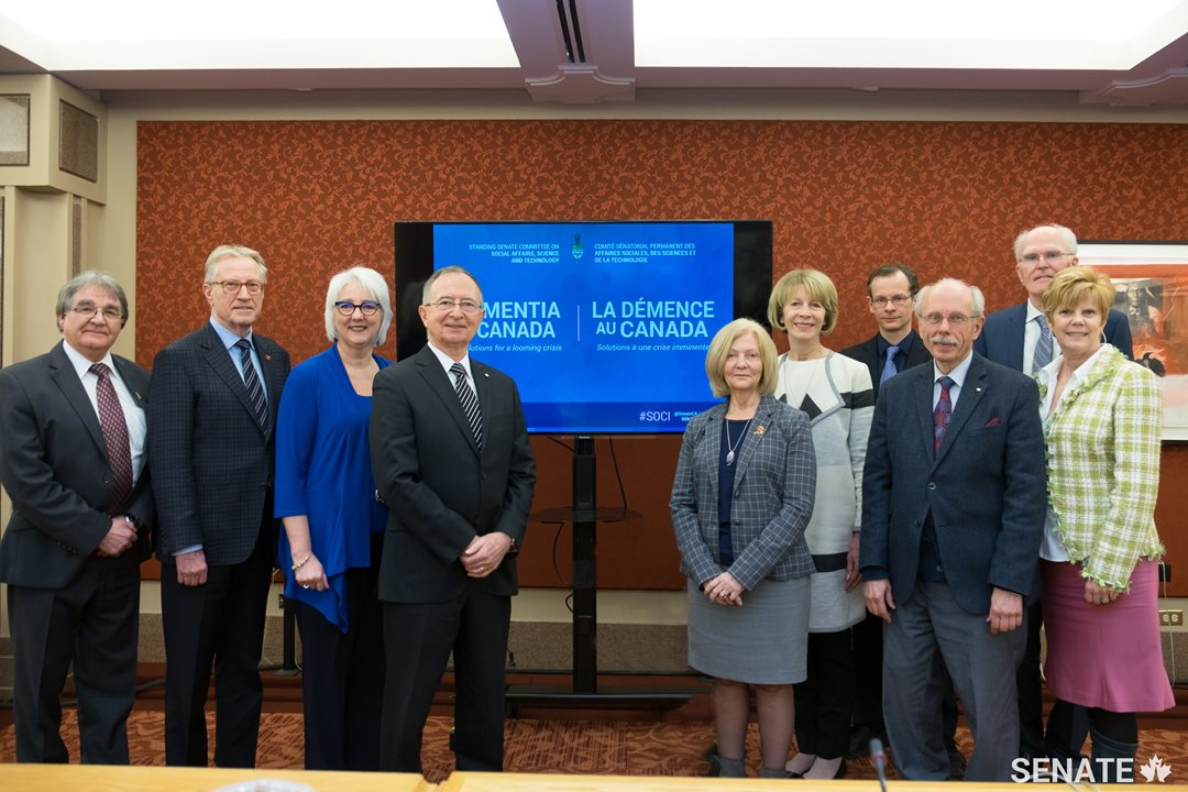 Participating in the panel discussion on dementia were (from left to right): Senator Charlie Watt; Senator Art Eggleton; Professor Linda Garcia, University of Ottawa Faculty of Health Sciences; Senator Kelvin Kenneth Ogilvie; Senator Carolyn Stewart Olsen; Debbie Benczkowski, Chief Operating Officer, Alzheimer Society of Canada; Dr. Frank Molnar, Vice-President of the Canadian Geriatrics Society; Dr. Antoine M. Hakim, Senior Neurologist at The Ottawa Hospital; Michael Duncan, a retired Navy commander who lives with dementia and informal caregiver Katherine Duncan.