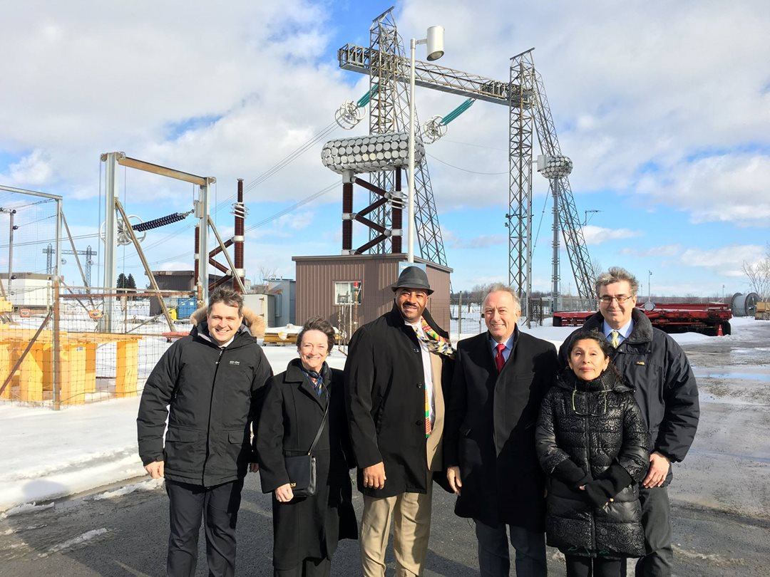 Jérôme Gosset, Director (far left) and Jean-Pierre Tardif, Communications and Marketing Advisor (far right) from Hydro Quebec's Research Institute pose with committee members Senators Griffin, Meredith, Massicotte and Galvez in front of some of the facilities high-tech testing equipment on February 8th, 2017 in Varennes.