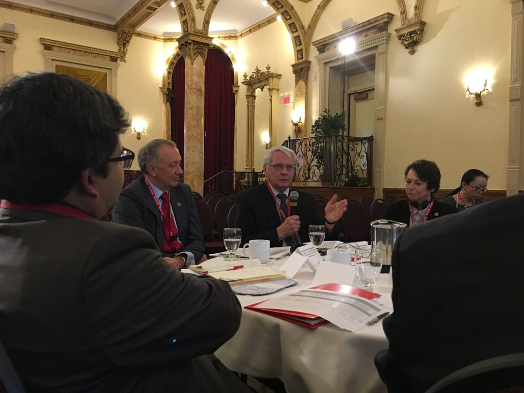 Senator Neufeld, Chair of the Committee, discusses the immense challenges Canadians are facing in trying to reduce our carbon footprint and meet the Government's greenhouse gas emission reduction targets with professors from McGill University's Trottier Institute for Sustainability in Engineering and Design, as Deputy Chair Senator Massicotte and Senator Griffin look on.