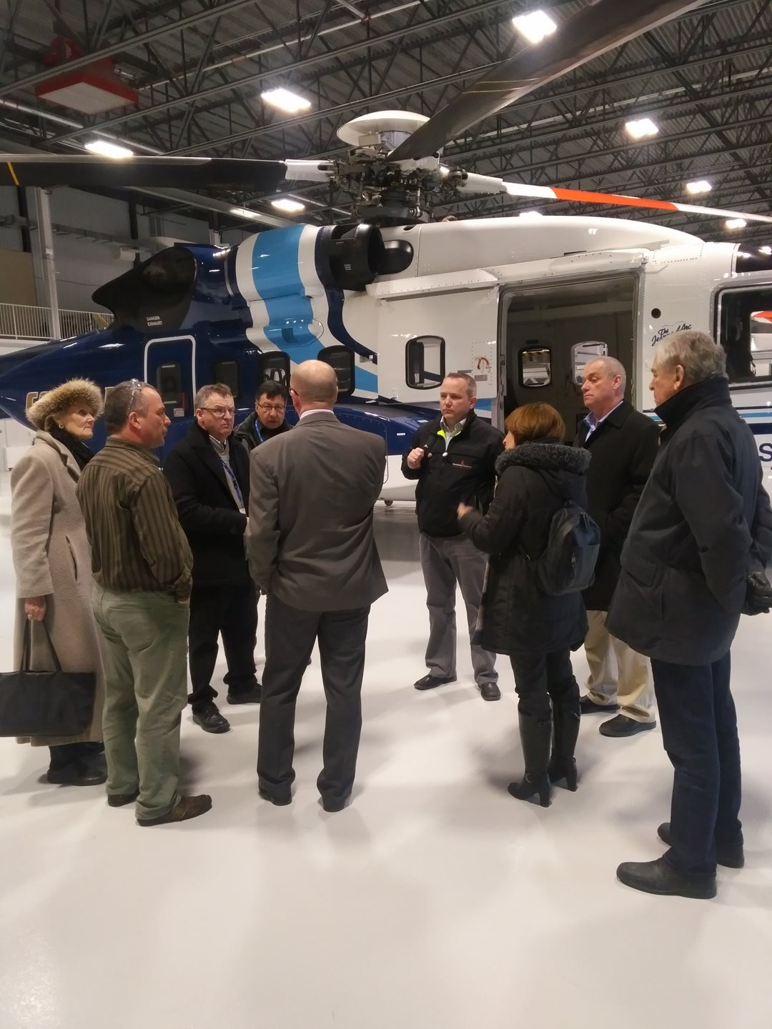 Senator Elizabeth Hubley, deputy chair of the committee, Senator Fabian Manning, committee chair, along with senators Daniel Christmas and Thomas McInnis, learn about Cougar Helicopters' facilities at St. John's airport.