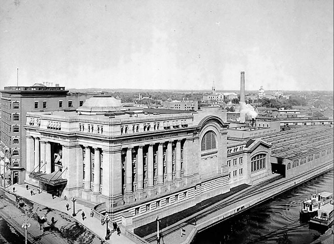Ottawa's Grand Trunk Central Station, later renamed Union Station, shortly after it was built in 1912. In the foreground is the single rail line that continued north along the Rideau Canal, eventually crossing the Ottawa River over the Alexandra Bridge to Quebec.