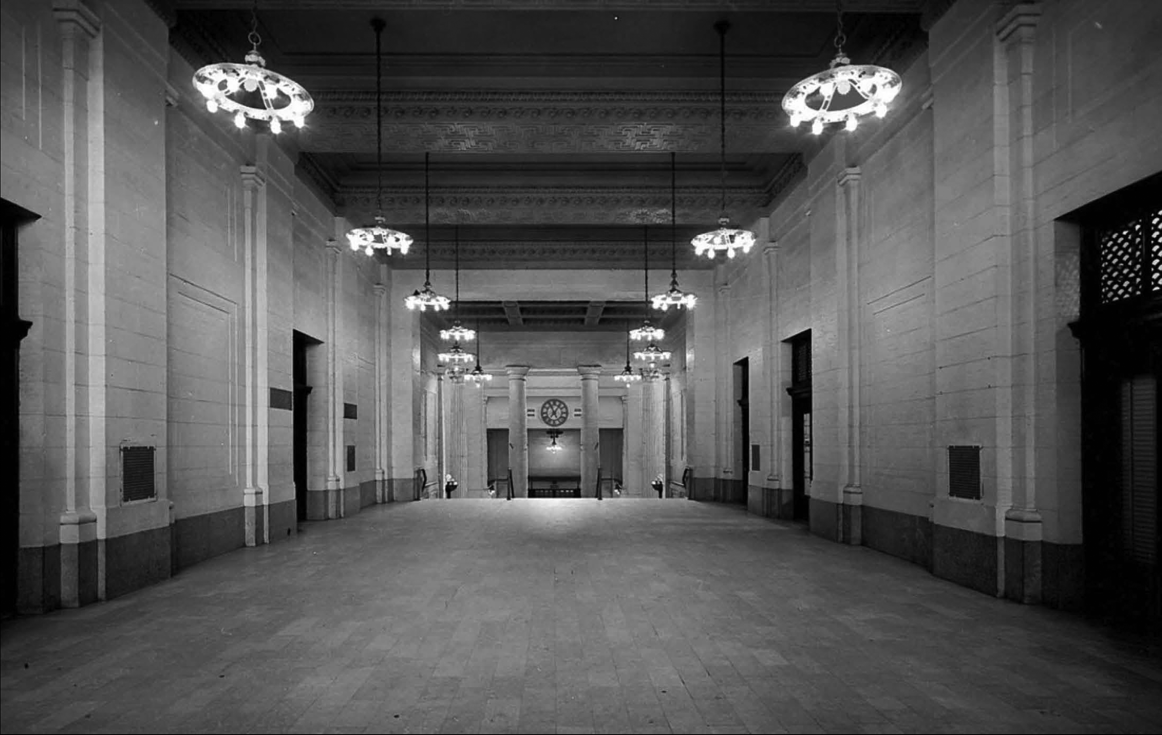 A long low-ceilinged corridor funnelled passengers from Union Station's entrance on Rideau Street to a flight of stairs that led down into the general waiting room.