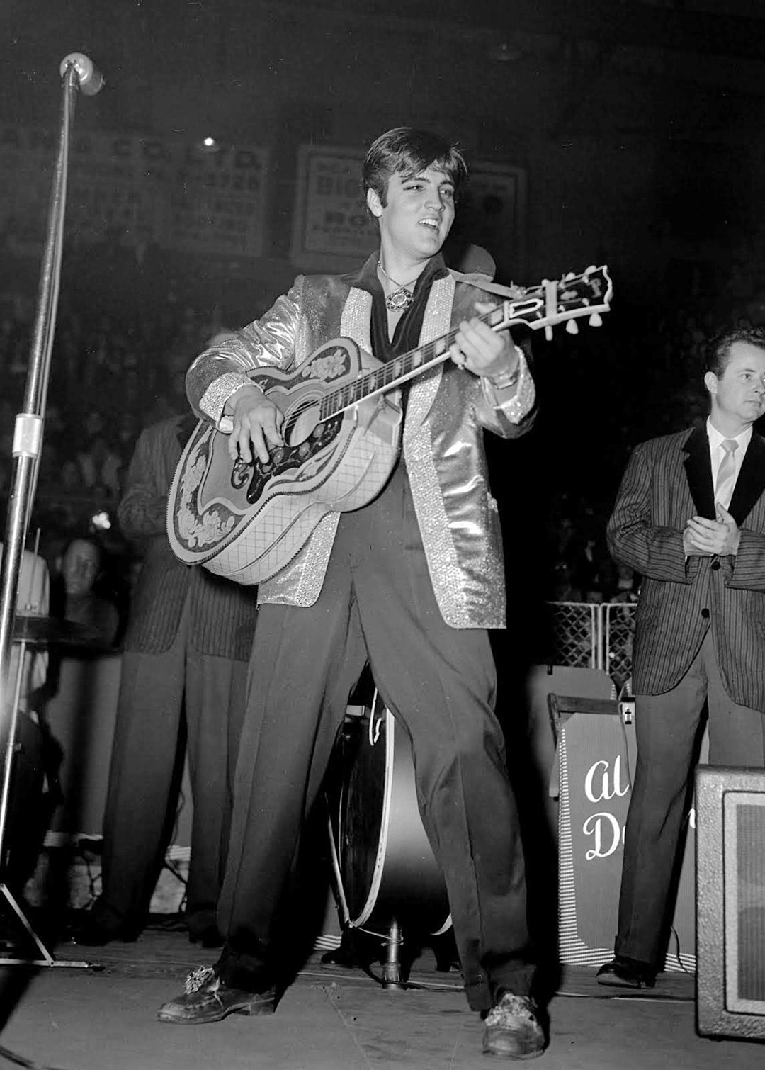 Elvis Presley performs to a capacity crowd of 9,000 fans at the Ottawa Auditorium on April 3, 1957.