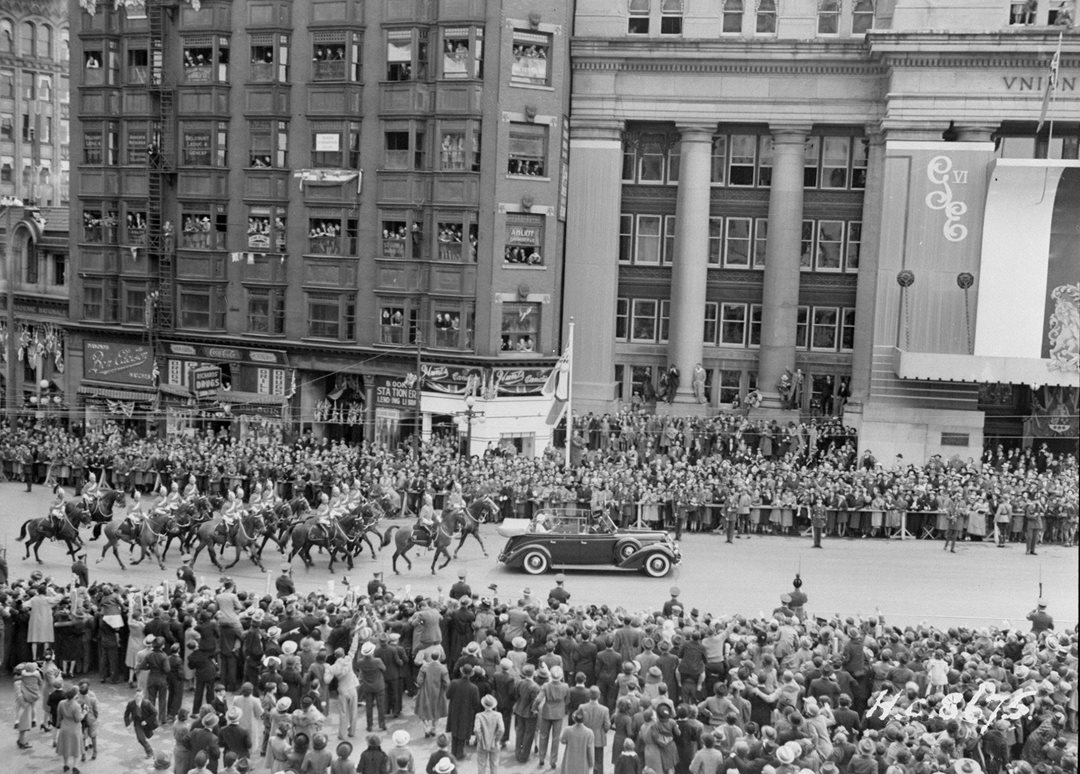 King George VI and his consort, Queen Elizabeth, later known as the Queen Mother, pass in front of Union Station on May 20, 1939, during a four-week cross-Canada royal tour.