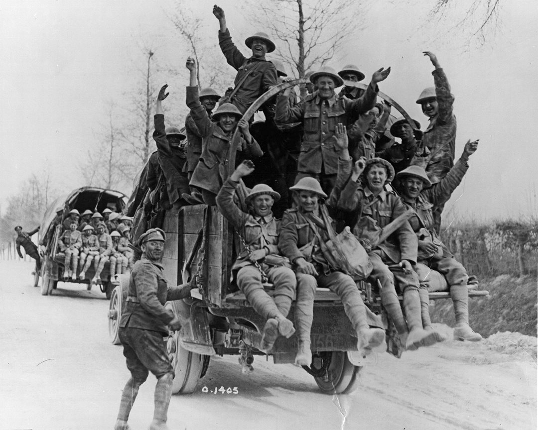 Victorious Canadian soldiers celebrate their victory at Vimy Ridge as they are transported behind the lines for a few days leave. (Library and Archives Canada)