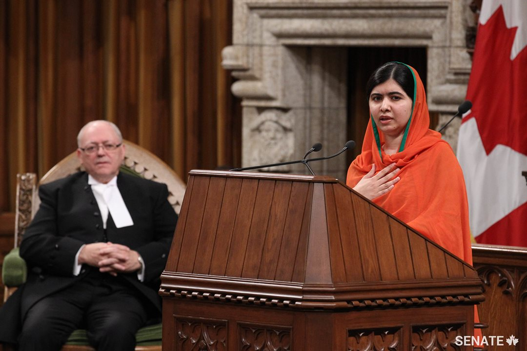 Speaker Furey looks on as Yousafzai addresses a joint session of the Senate and House of Commons.