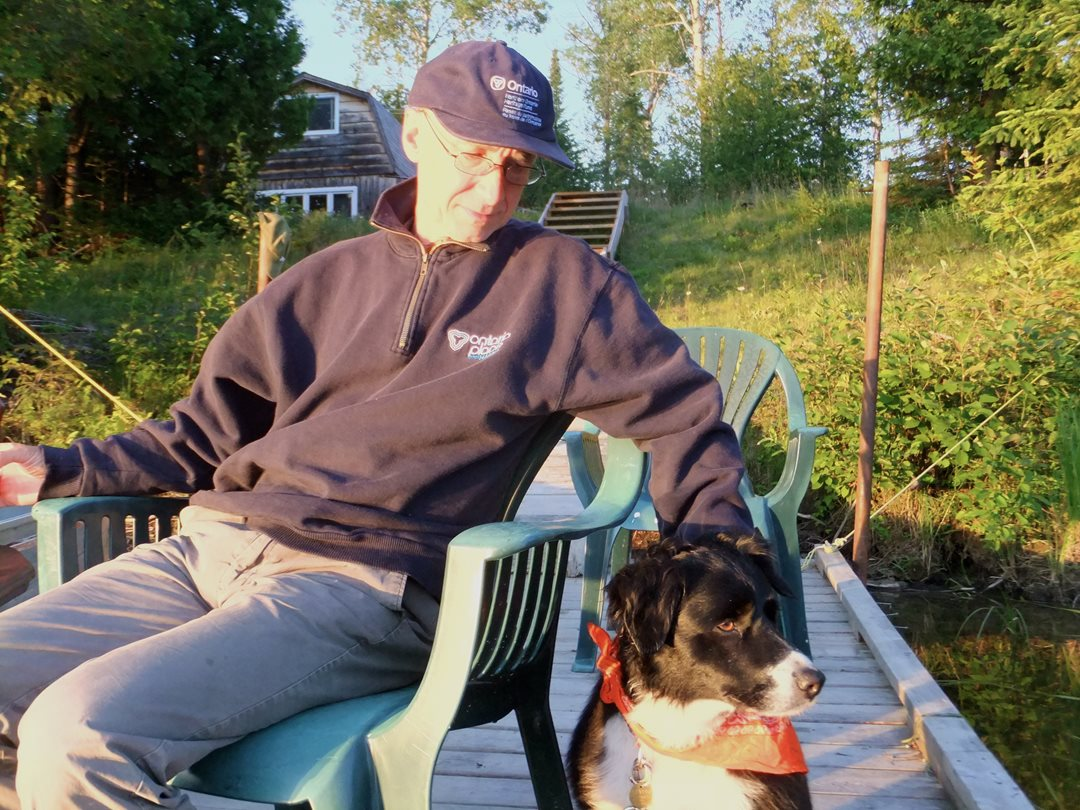 Senator Dean with his dog Stella at his camp on the Montreal River. Stella loved to swim and had a keen nose for bears, rabbits and grouse.