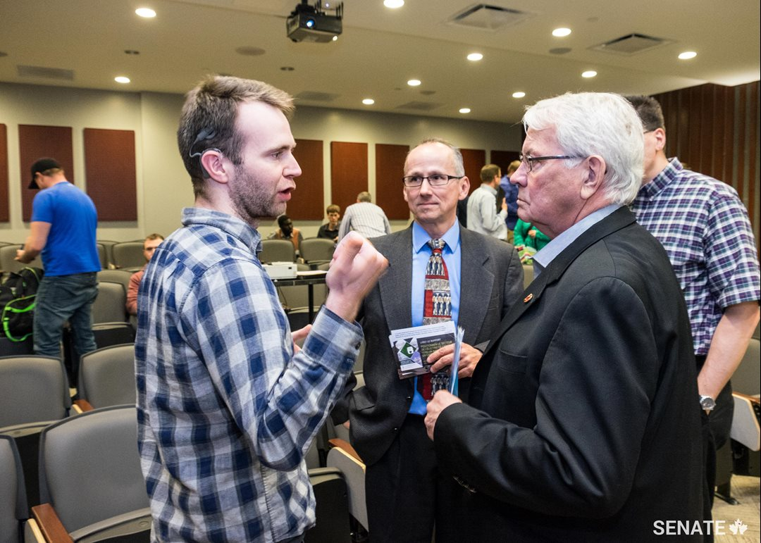 Peter Clifford, a student in instrumentation control technology, speaks to Senator Neufeld after his presentation to New Brunswick Community College students.