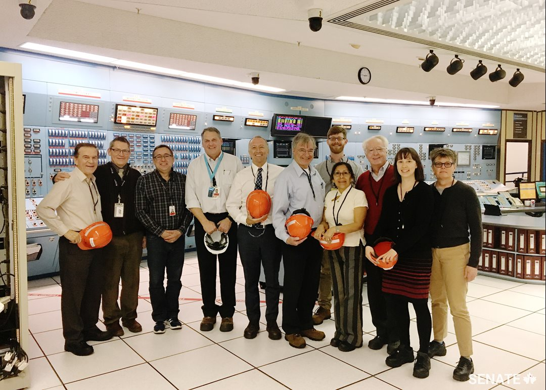 Committee members visit the simulator in the Point Lepreau Nuclear Generating Station.