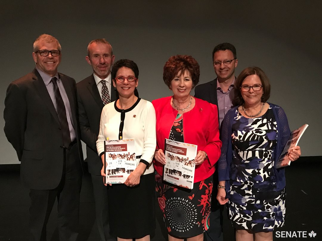 Senators Claudette Tardif, centre right, and Raymonde Gagné, centre left, pose with French-language advocates after releasing a report on the state of French-language education in British Columbia.