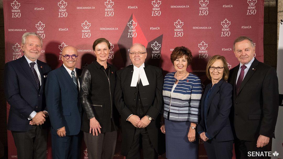 Senators Peter Harder, René Cormier and Lucie Moncion, Senate Speaker George J. Furey, Senators Claudette Tardif, Judith Seidman and Serge Joyal.