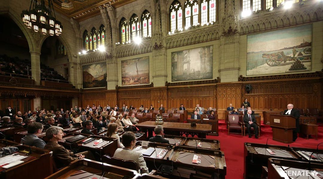 Senate Speaker George J. Furey welcomes participants at the Senate Symposium on the 150th Anniversary of Canadian Confederation.