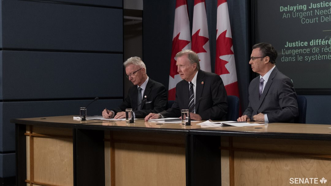 Senate Committee on Legal and Constitutional Affairs member Senator Pierre-Hugues Boisvenu, committee Chair Senator Bob Runciman and Deputy Chair Senator George Baker describe their committee's report on court delays on Wednesday, June 14, 2017. The report makes 50 recommendations to alleviate the strain on Canada's court system.