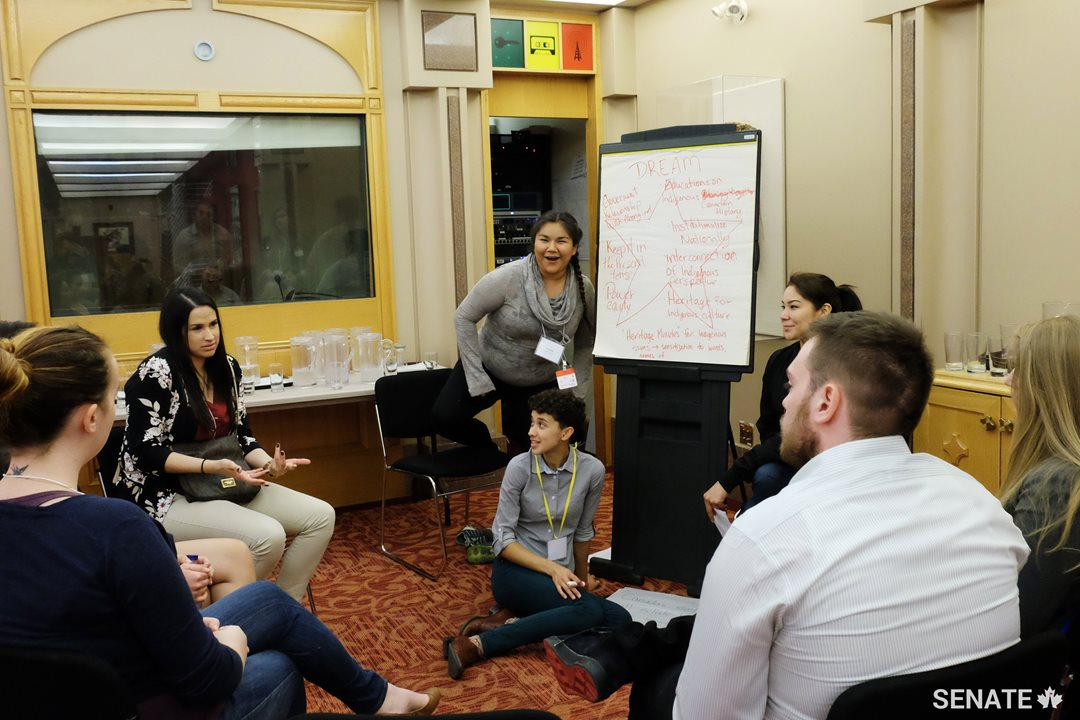 Youth forum facilitators Candy Decourcie and Tamara Owl get some input from youth leader Holly Jane Sock.