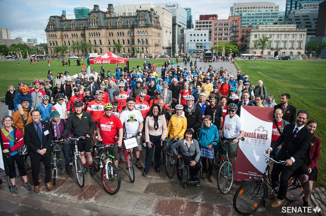 Bike Day on the Hill took place on Thursday, June 1, 2017, starting at the steps of Parliament. Participating cyclists gather around Senators Nancy Greene Raine, Chantal Petitclerc and Dennis Patterson.
