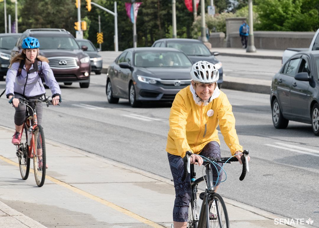 """National Health & Fitness Day is pleased to help connect Canadian cycling advocates with federal legislators for a discussion on the promotion of cycling.  Active transportation is an excellent way to increase overall physical activity of Canadians and help reduce traffic congestion,"" says Senator Raine, seen here riding up the Portage Bridge over the Ottawa River en route to Gatineau, Quebec."
