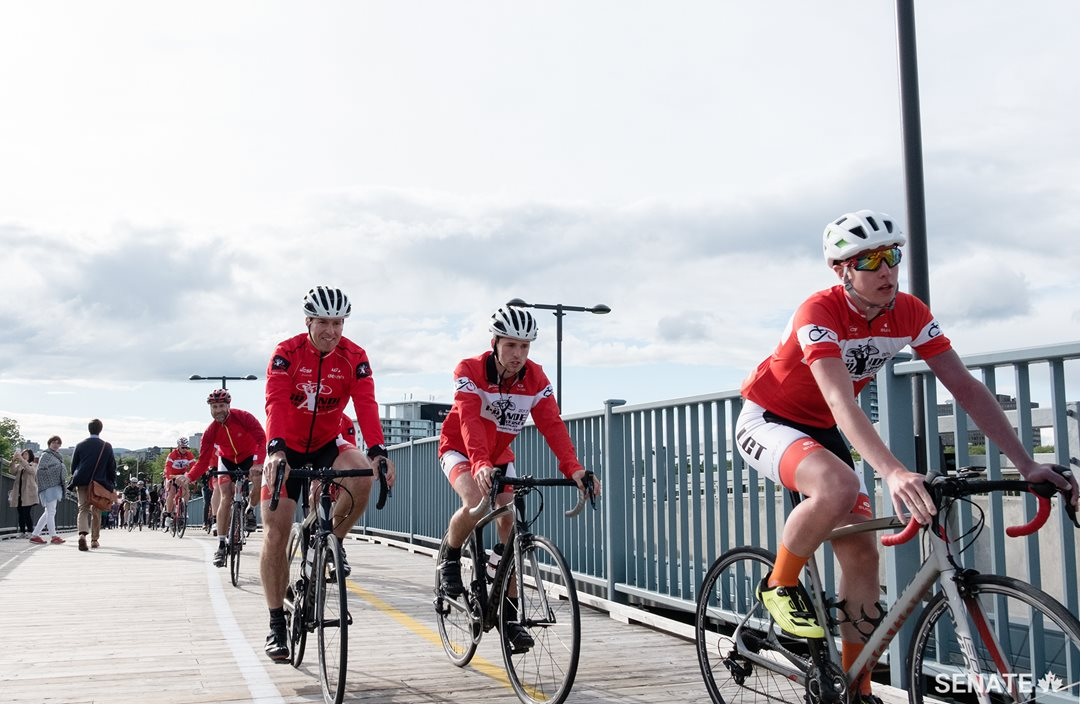 Cyclists cross back from the Quebec side of the Ottawa River via the Alexandra Bridge.