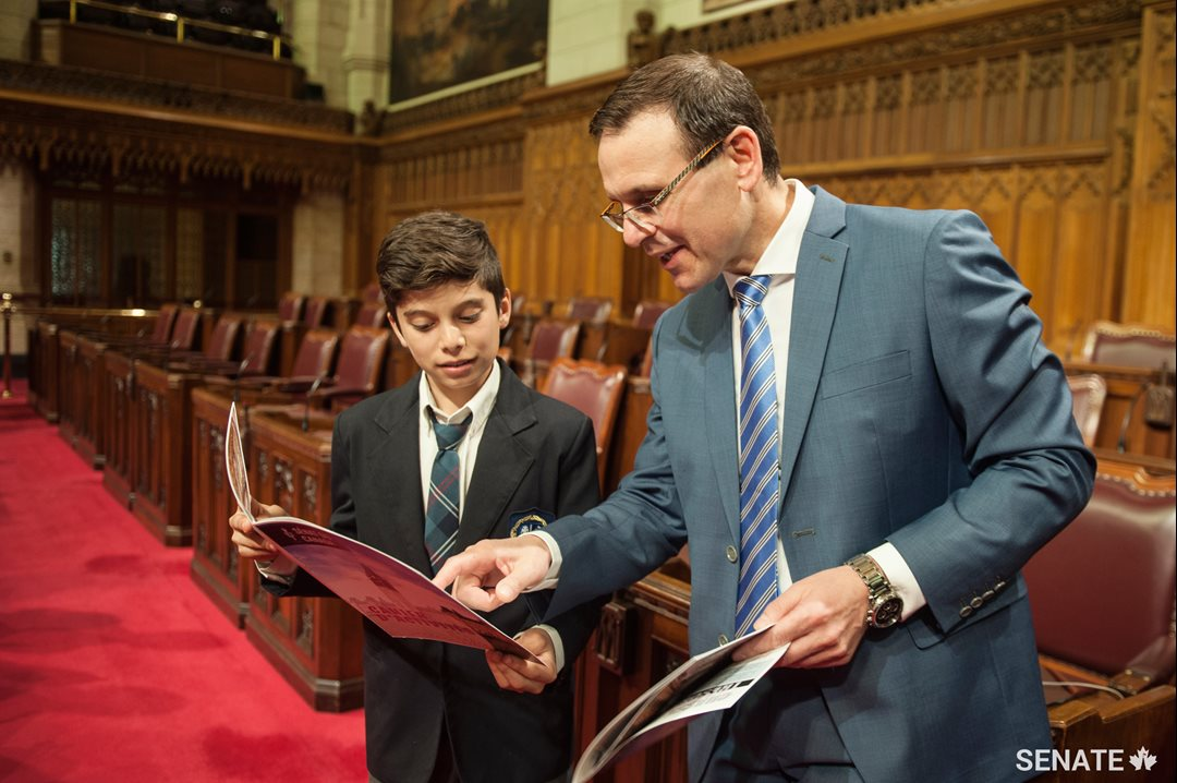 Senator Housakos compares notes with a student — some of the questions in the Senate's new activity booklet are tough!