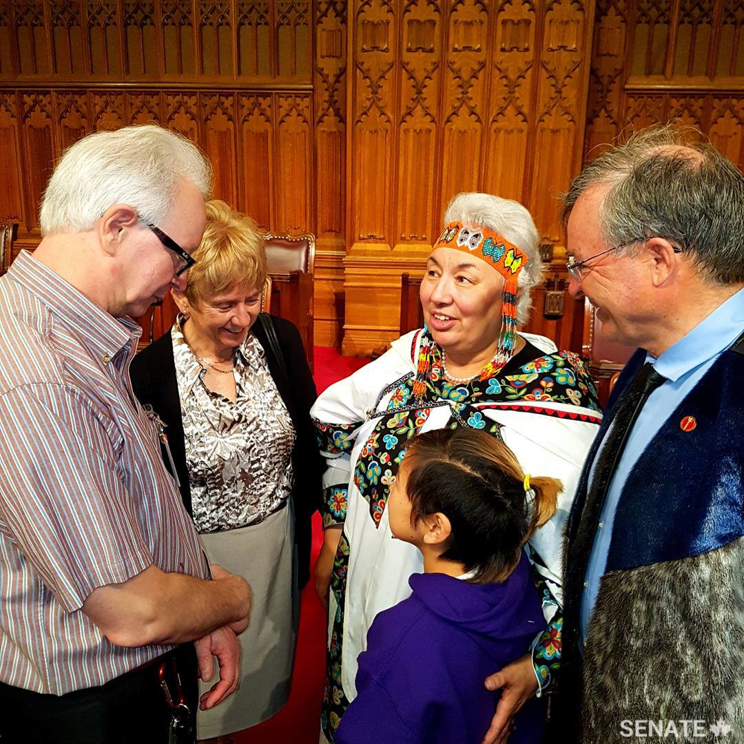 From right, deputy chair of the Senate Committee on Aboriginal Peoples Senator Dennis Patterson, Inuit elder Manitok Thompson, Senator Nancy Greene Raine, and Thompson's family get to know each other during the Youth Indigenize the Senate event.