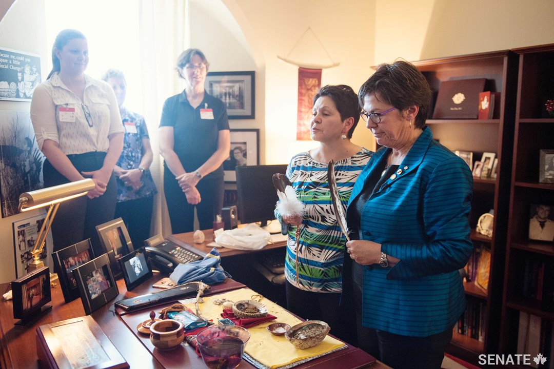 Senator Kim Pate holds a traditional smudging ceremony in her office on Parliament Hill. Senator Pate is a member of the Senate Committee on Aboriginal Peoples.