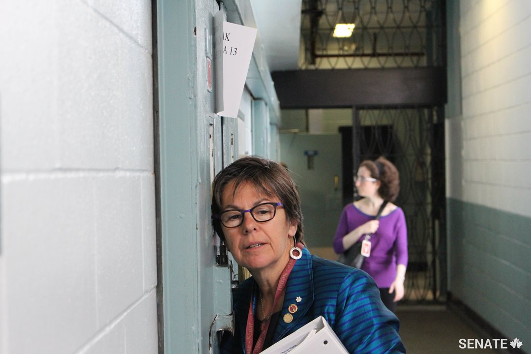 Senator Kim Pate listens to a man being held in the segregation unit at Millhaven Institution, a prison near Kingston, Ontario.