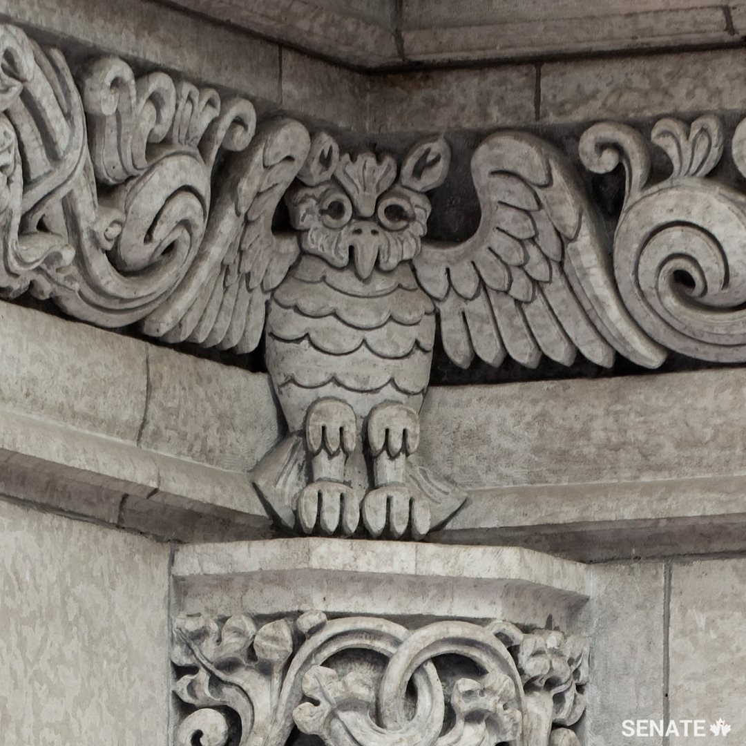 One of four owls that stand at the corners of the ceiling frieze in the Senate foyer.