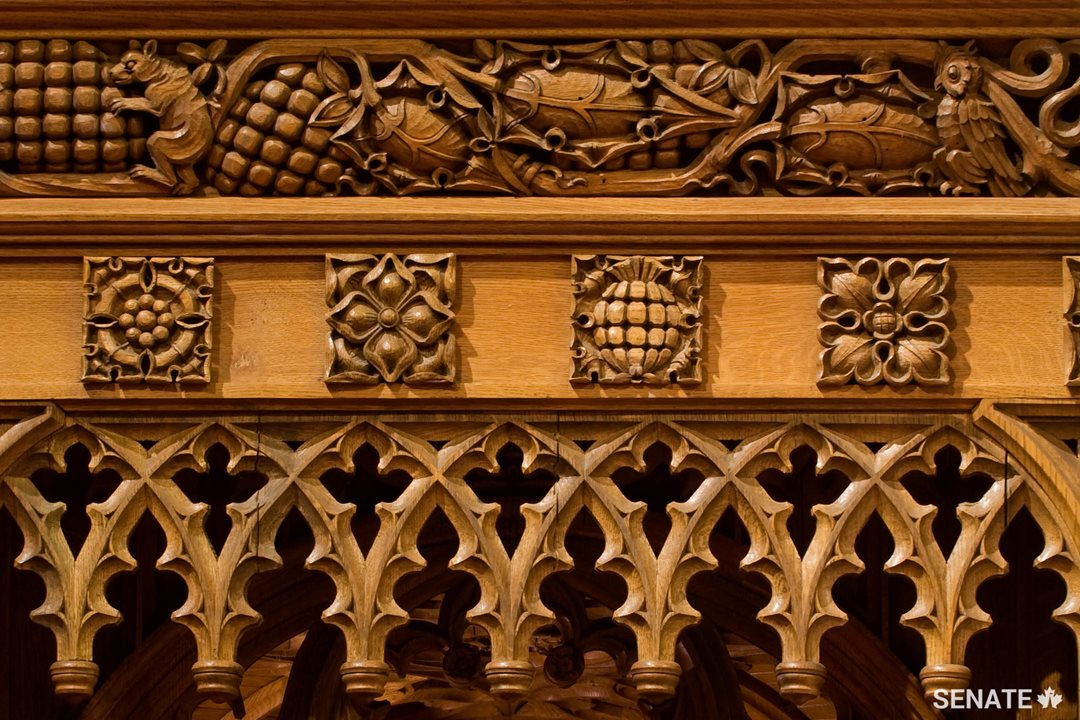 Squirrels, rabbits and jays, representing industry and incessant energy, cavort in the chamber's intricate oak wainscoting, carved in the 1920s.