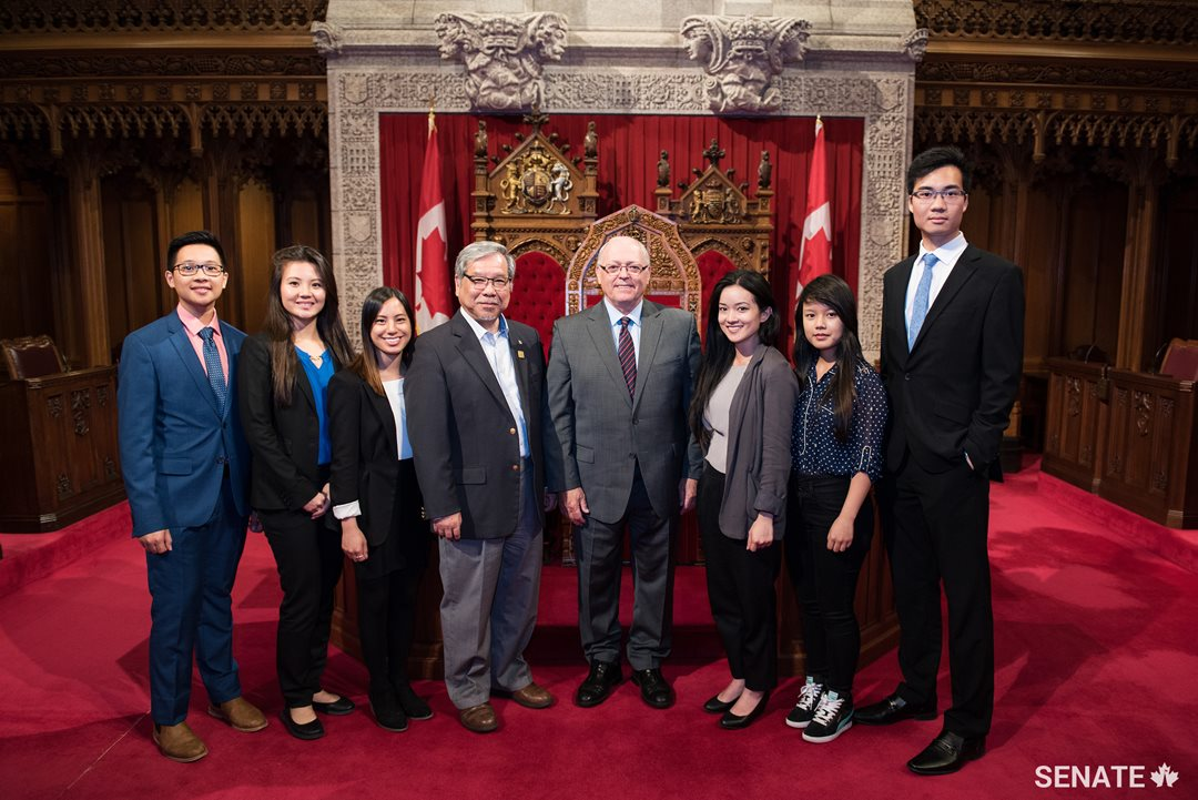 Senator Thanh Hai Ngo and Speaker of the Senate George J. Furey visit the Senate Chamber with students from the fifth edition of the internship program.