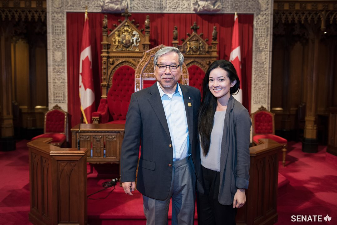 Senator Ngo and Kim Nguyen, from Vancouver, pose in the Senate Chamber.