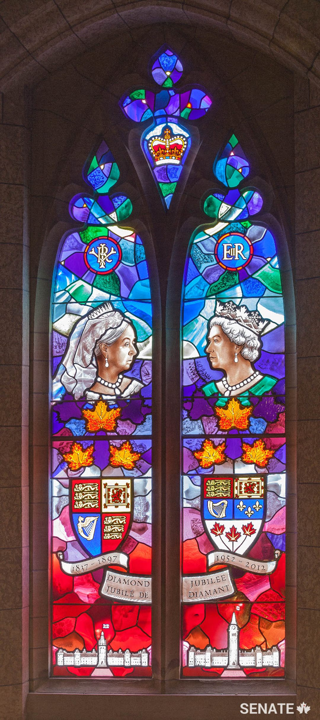 This window commemorates the Diamond Jubilee of Queen Elizabeth II in 2012, marking her 60 years on the throne. It juxtaposes her likeness with that of her great great grandmother, Queen Victoria, who celebrated her Diamond Jubilee in 1897.