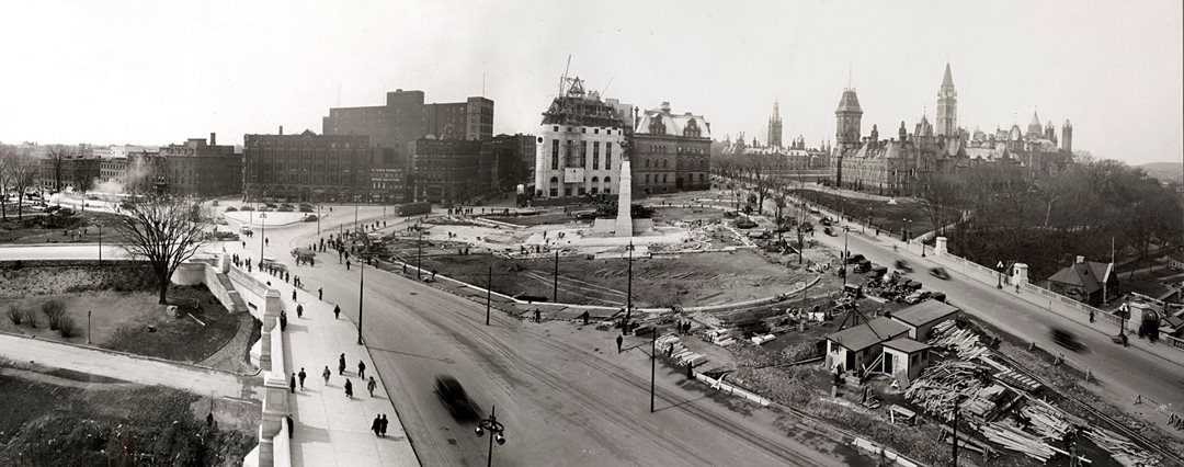 This 1938 composite photo shows construction of the National War Memorial and Confederation Square nearing completion. The old post office has been demolished and its replacement, seen behind the War Memorial, is well underway. (Library and Archives Canada)