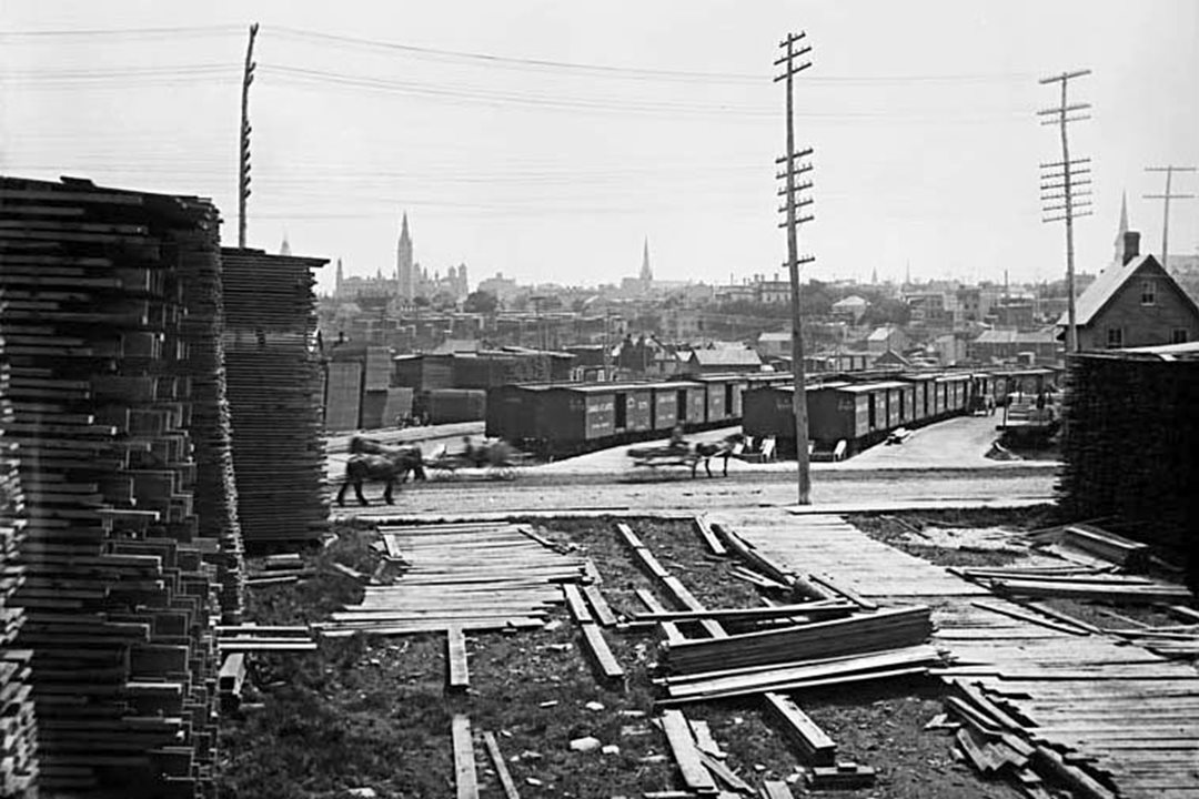 Booth's lumber mill near Chaudière Falls was the largest in the world in the 1890s. Parliament Hill's West Block is visible in the background. (Library and Archives Canada)