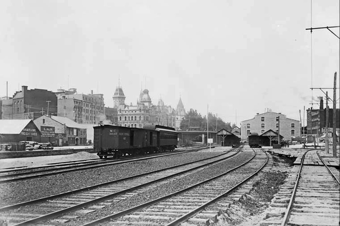 The rail sheds south of Central Station are visible in this 1895 photograph along with Parliament Hill and Ottawa's old post office in the background. (Library and Archives Canada)