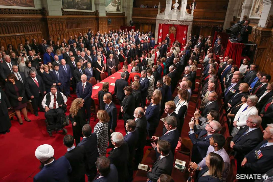 Guests rise as Governor General Designate Julie Payette enters the Senate Chamber.