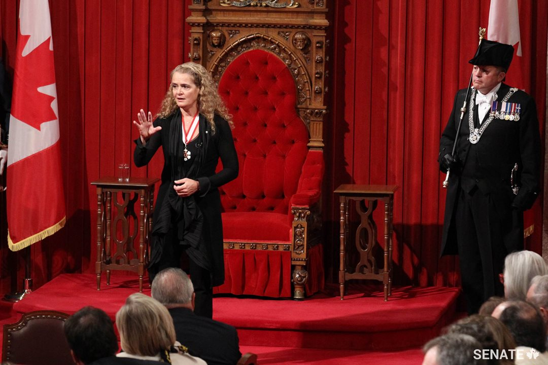 Her Excellency the Right Honourable Julie Payette delivers her first address as Governor General. Usher of the Black Rod J. Greg Peters looks on.