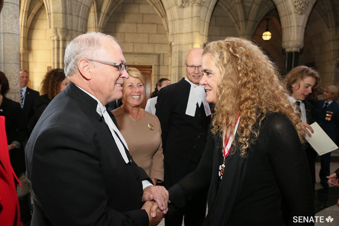 Senate Speaker George J. Furey exchanges a warm handshake with Governor General Designate Julie Payette as she arrives on Parliament Hill for her swearing-in as Canada's 29th Governor General.