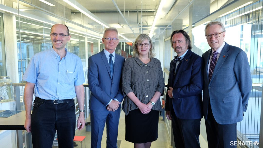 Senators meet with University of Waterloo vice-president Sandra Banks, centre, and Engineering professor Krzysztof Czarnecki, left, inside the Sedra Student Design Centre at the University of Waterloo on October 3, 2017.