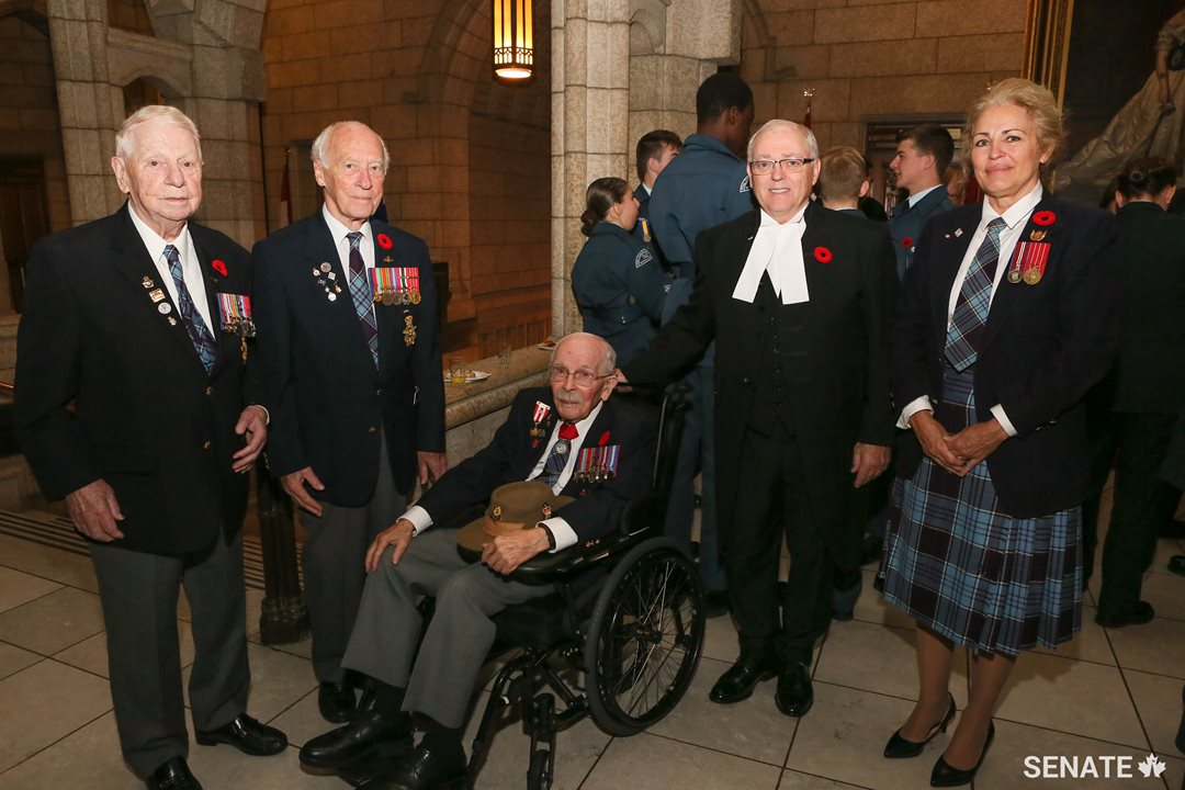 Speaker Furey spends some time with veterans of the Canadian Armed Forces.