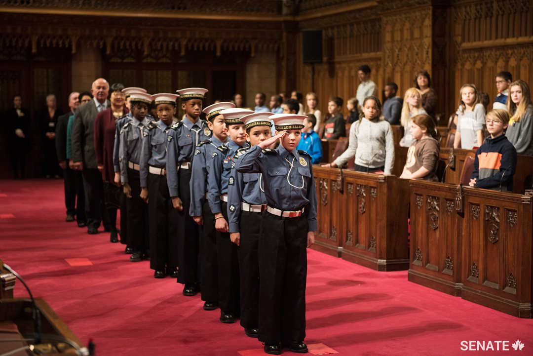 Cadets from the Navy League of Canada usher senators into the Red Chamber to kick off National Child Day celebrations.