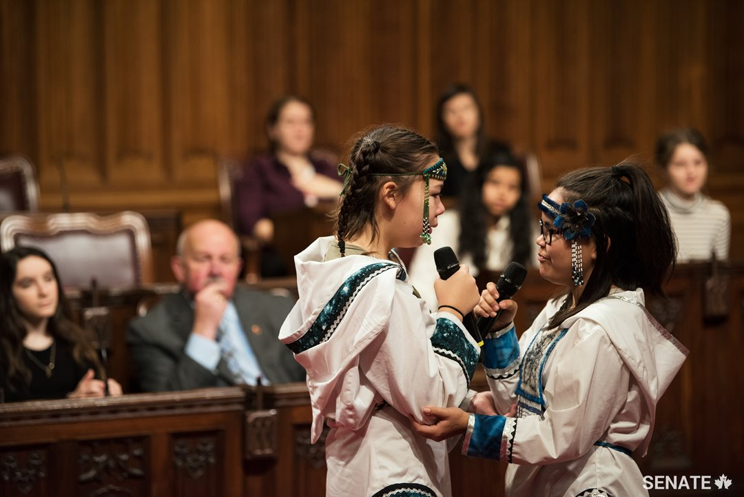 Inuit throat singers Cailyn DeGrandpre, left, and Samantha Kigutak-Metcalfe try to make each other laugh during a performance.