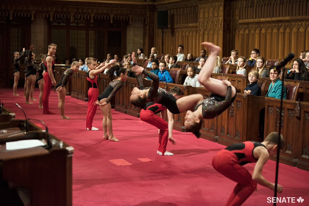 Members of UniGym Gatineau flip out during National Child Day in the Senate Chamber.