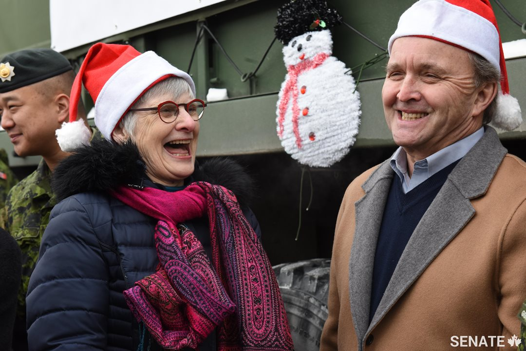 Senators Patricia Bovey and Grant Mitchell share a laugh during the Toys for Tots collection on Friday, December 15, 2017.