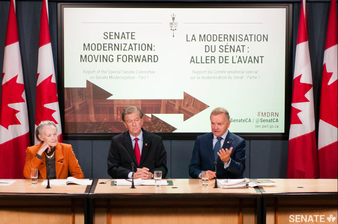 Senator Joyal is joined by Senators Thomas J. McInnis and Elaine McCoy at the launch of the Senate Committee on Senate Modernization's <a href='https://sencanada.ca/en/sencaplus/news/modernization-a-senate-more-open-more-inclusive-more-effective/'>first report</a> in October 2016.