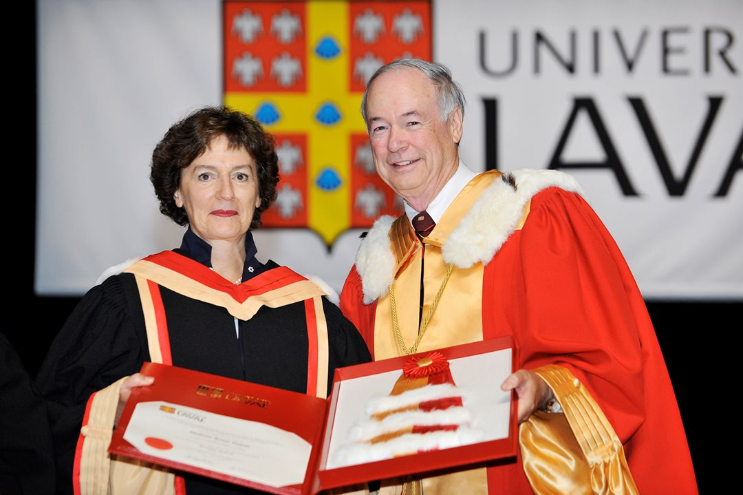 Rector Denis Brière presents Senator Dupuis with an honorary Doctor of Laws degree from the University of Laval in June 2012.