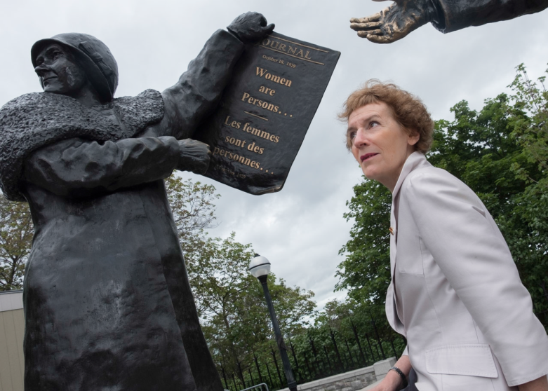 Senator Dupuis draws inspiration from the <a href='https://sencanada.ca/en/sencaplus/how-why/why-the-persons-case-matters/'>Persons Case</a> statue on Parliament Hill. Senator Dupuis served as a commissioner with the Canadian Human Rights Commission from 1989 to 1995, where she took a special interest in such issues as discrimination against women, sexual harassment, pay equity and employment equity.