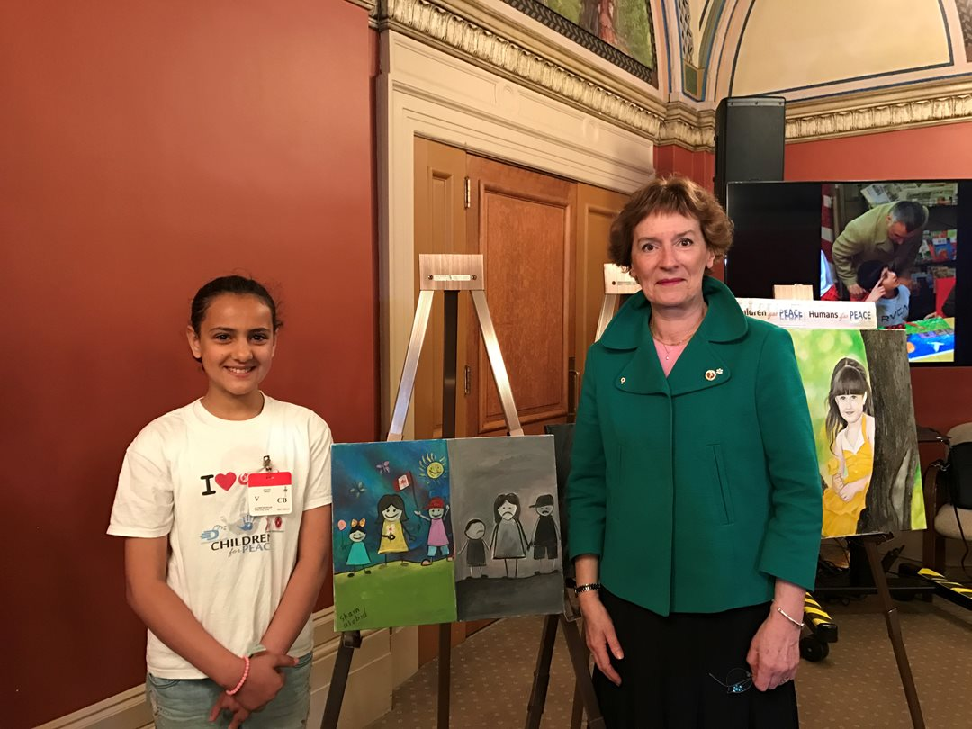 Senator Dupuis takes part in Children For Peace, a program that brought more than a dozen Syrian refugee children to Parliament Hill to display paintings inspired by their experiences in May 2017.