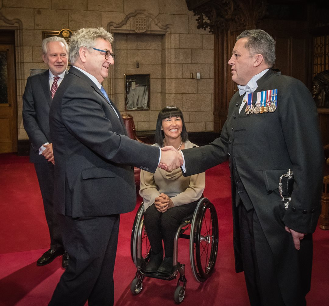 Senator Forest is sworn in as a senator in November 2016, joined here by Senator Chantal Petitclerc, the Usher of the Black Rod Greg J. Peters and Senator Peter Harder.