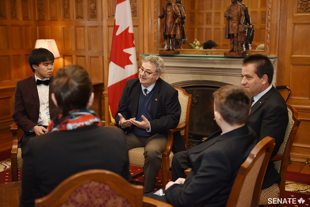 Senator Forest speaks with <a href='https://sencanada.ca/en/sencaplus/news/senate-continues-partnership-with-forum-for-young-canadians/'>Forum for Young Canadians</a> participants about the importance of getting involved in one's own community in February 2018.